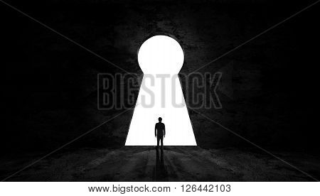 Businessman standing to exit key room to success