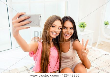 Portrait Of Happy Beautiful Young Girl Making Selfie