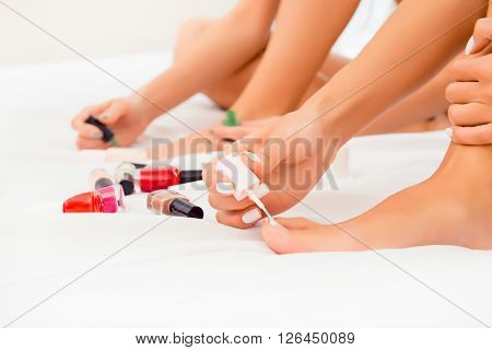 Close Up Photo Of Women's Foot With Painted Nails