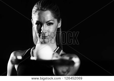 Young Woman Holding Racket With Ball