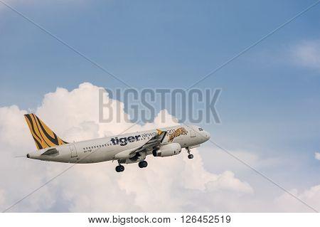 Tiger Airways Plane Flying In Sky