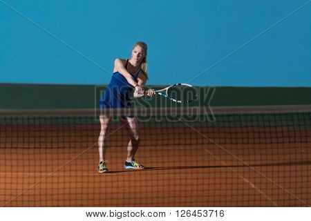 Young Girl Playing Tennis Hitting Ball
