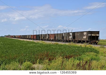 HUNTER, NORTH DAKOTA, August 19, 2016: A Burlington Northern Santa Fe freight train waits on the tracks of the Red River Valley of the North