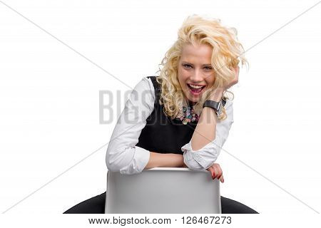 Flirty and funny woman smiling and sitting backwards on chair