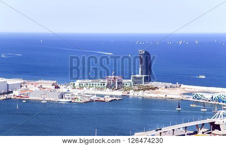 SPAIN, BARCELONA, JUNE, 27, 2015 - A view aerial from the hill of Montjuic on the port and Hotel W Barcelona, Catalonia, Spain.