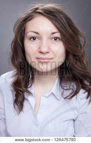 Portrait of a young woman with no makeup done no edit and no filter applied.