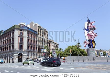 SPAIN, BARCELONA, JUNE, 27, 2015 - Roy Lichtenstein Head sculpture in Barcelona, Spain. Represents the face of a woman. Made of concrete and ceramics, it is the ceramic cladding that pays homage to Barcelona and its famous son Antoni Gaudi.