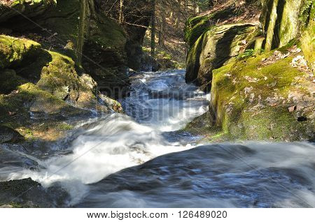 Water flowing through Dean's Ravine waterfall on the mohawk trail in Falls Village Connecticut in the spring.
