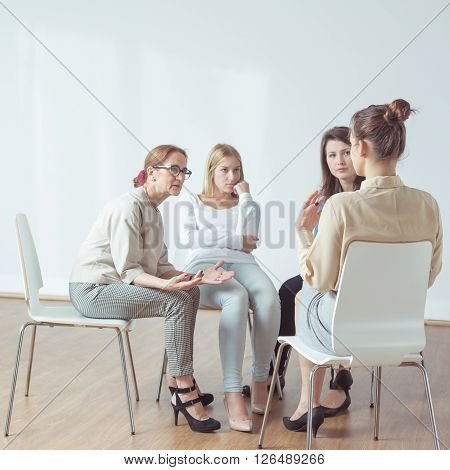 Support group during session with experienced psychotherapist