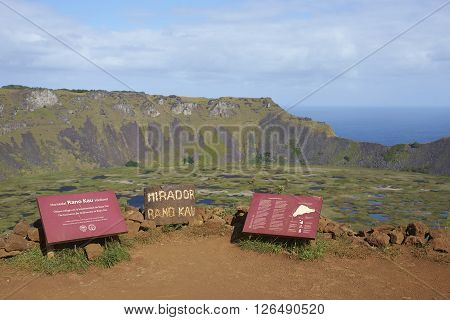 EASTER ISLAND - APRIL 6, 2016: Information signs on the edge of the caldera of the extinct volcano Rano Kau within the UNESCO World Heritage Site of Rapa Nui National Park on Easter Island.