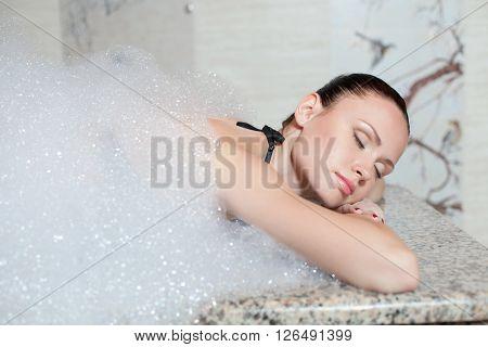 Young beautiful woman having massage in hamam.
