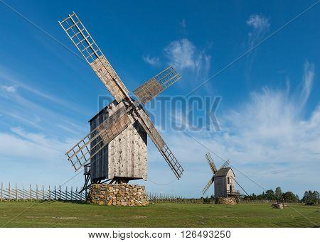 Two traditional wooden windmills in Angla, Island of Saaremaa, Estonia.