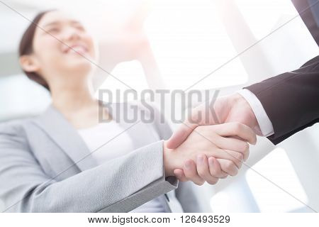 Group of success business people team shake hands in office with city background asian