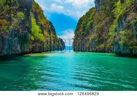 Beautiful tropical landscape with blue lagoon and mountain islands, El Nido, Palawan, Philippines