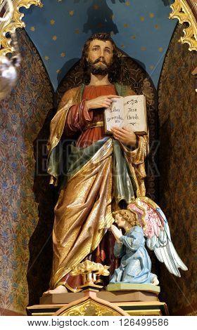 STITAR, CROATIA - NOVEMBER 24: Saint Matthew statue on the main altar in the church of Saint Matthew in Stitar, Croatia on November 24, 2015