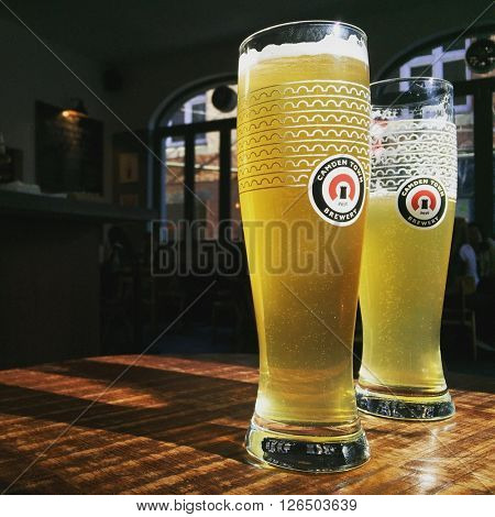 LONDON - APRIL 20: Two Pints of Camden Town Gentleman's Wit Beer at The Horseshoe Pub on April 20, 2016 in Hampstead, London, UK.