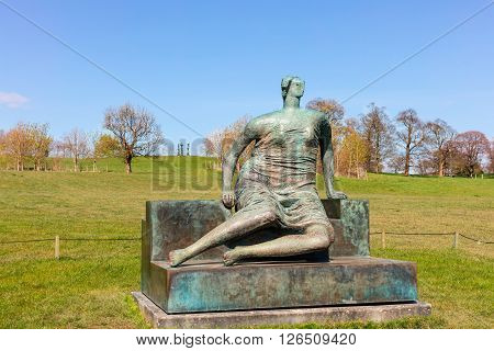 WAKEFIELD, YORKSHIRE, UK - APRIL 19: Draped Seated Woman, c1957-58 bronze sculpture by Henry Moore in Yorkshire Sculpture Park on April 19, 2016.