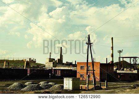 Industrial landscape - copper-smelting manufacture in Karabash Chelyabinsk region Russia. Retro tones applied.