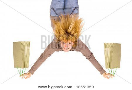 a girl with shopping bags upside down  - See similar images of this