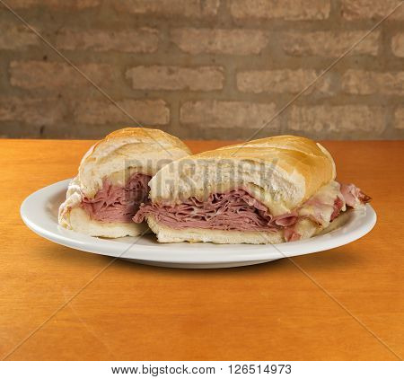 Mortadella traditional Italian sausage sandwich. Wood background.