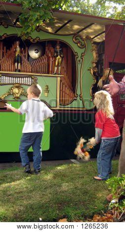 Boy And Girl Dancing To A Barrel Organ.
