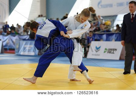 ST. PETERSBURG, RUSSIA - APRIL 16, 2016: Match Daria Pichkaleva (white) vs Aida Bikbova, both of Russia, during the Junior European Judo Cup. Athletes from 22 countries participated in the competition