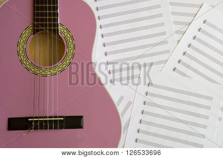 Violet guitar for children with treble clef