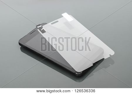 a scratch protective film on a smartphone /  smartphone care and maintenance concept