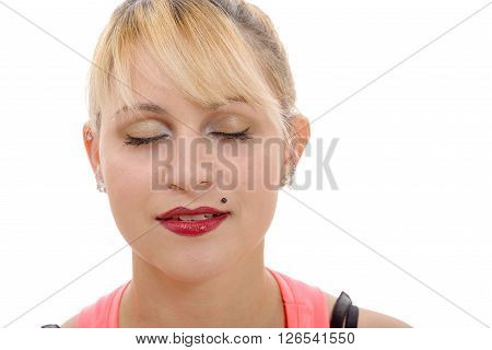 Close-up portrait of young closing eyes woman's isolated on white background