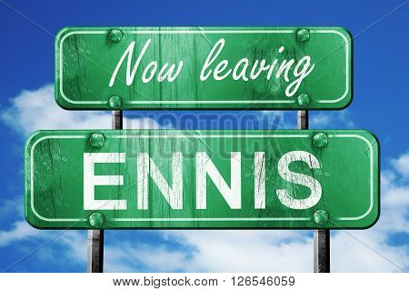 Now leaving ennis road sign with blue sky