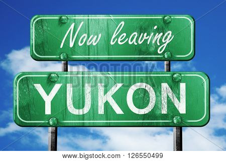 Now leaving yukon road sign with blue sky