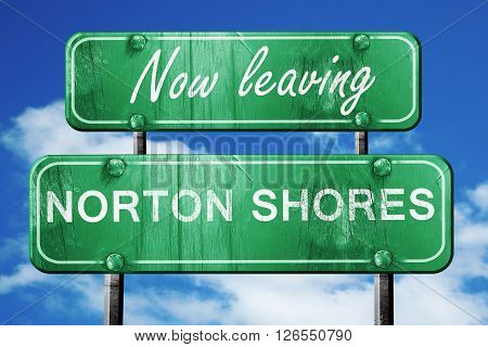 Now leaving norton shores road sign with blue sky