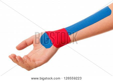 Arm stabilised with kinesotape after injury isolated