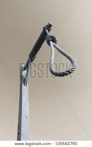 Gallows and hangman noose against a dark sky