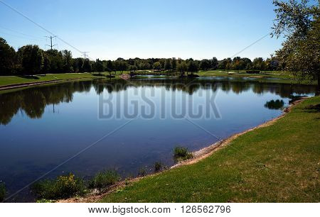 A large pond is a central feature of Settlers' Park in Plainfield, Illinois.