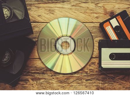 video tapes audio tapes and compact disc on a wooden table