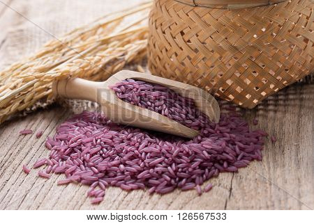 Closeup Purple rice on wooden background. rice