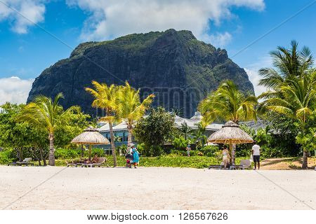 Le Morne Mauritius - December 7 2015: White sand beach near Le Morne Brabant mountain Mauritius. Iconic Le Morne Brabant (556m) is a stunning rock crag.
