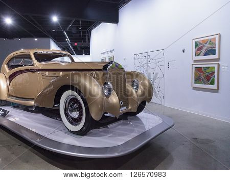 Los Angeles, CA, USA -- April 16, 2016: Gold 1937 Delage D8-120 Coupe Aerosport by Letourneur et Marchand at the Petersen Automotive Museum in Los Angeles, California, United States. ** Note: Visible grain at 100%, best at smaller sizes