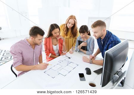 business, startup, architecture and people concept - creative architect team or students with blueprint working at office