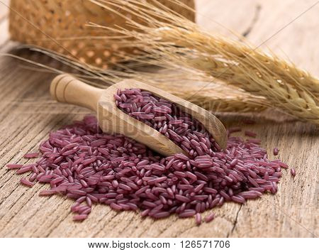 Closeup Purple rice on wooden background. food