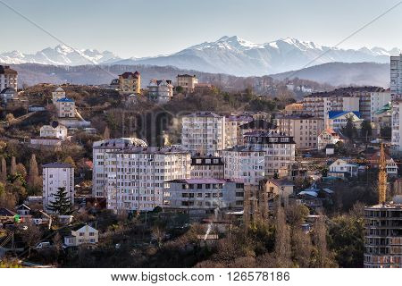 The view Sochi on a background of snow-capped mountain ranges. Russia