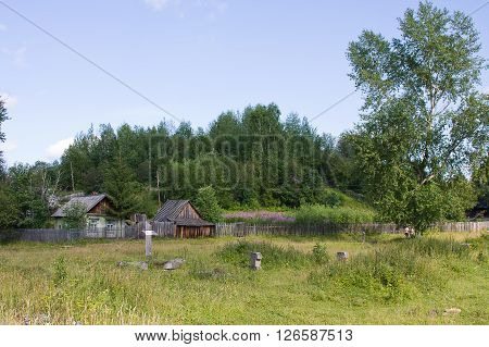 wooden houses are in a village sunny summer day, Russia
