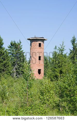 brick tower in field summer day, Russia