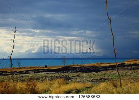 Coast of the Van Lake. Autumn. Cloudy Sky.