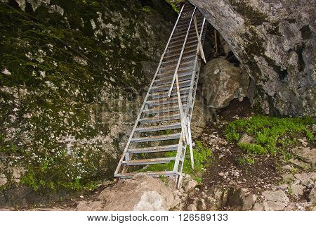 a metallic stair is in a rock
