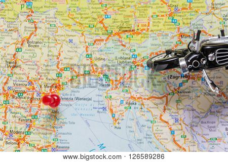 classic black motobike on map. travel planning.