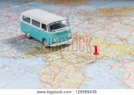 classic blue bus on map. travel planning
