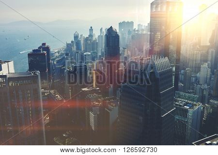View from the roof of a modern city with tall office and commercial buildings at beautiful sunset. Developed business district with high skyscrapers with contemporary architecture in New York poster
