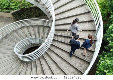 Top view of business people going up the step